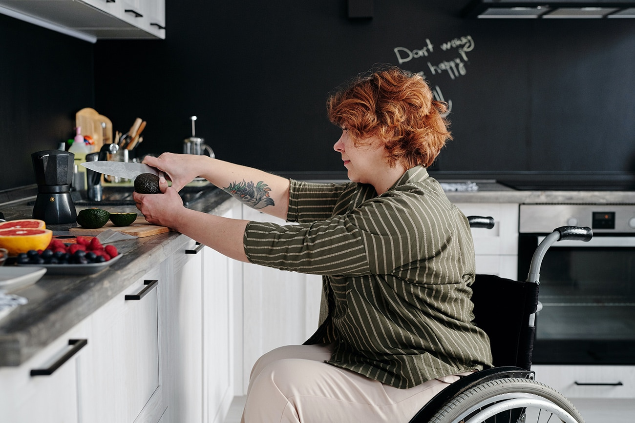 Woman in a wheelchair cooking. People with disabilities.