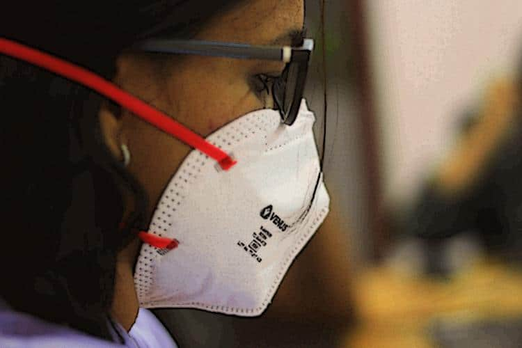 Woman wearing an N95 respirator.